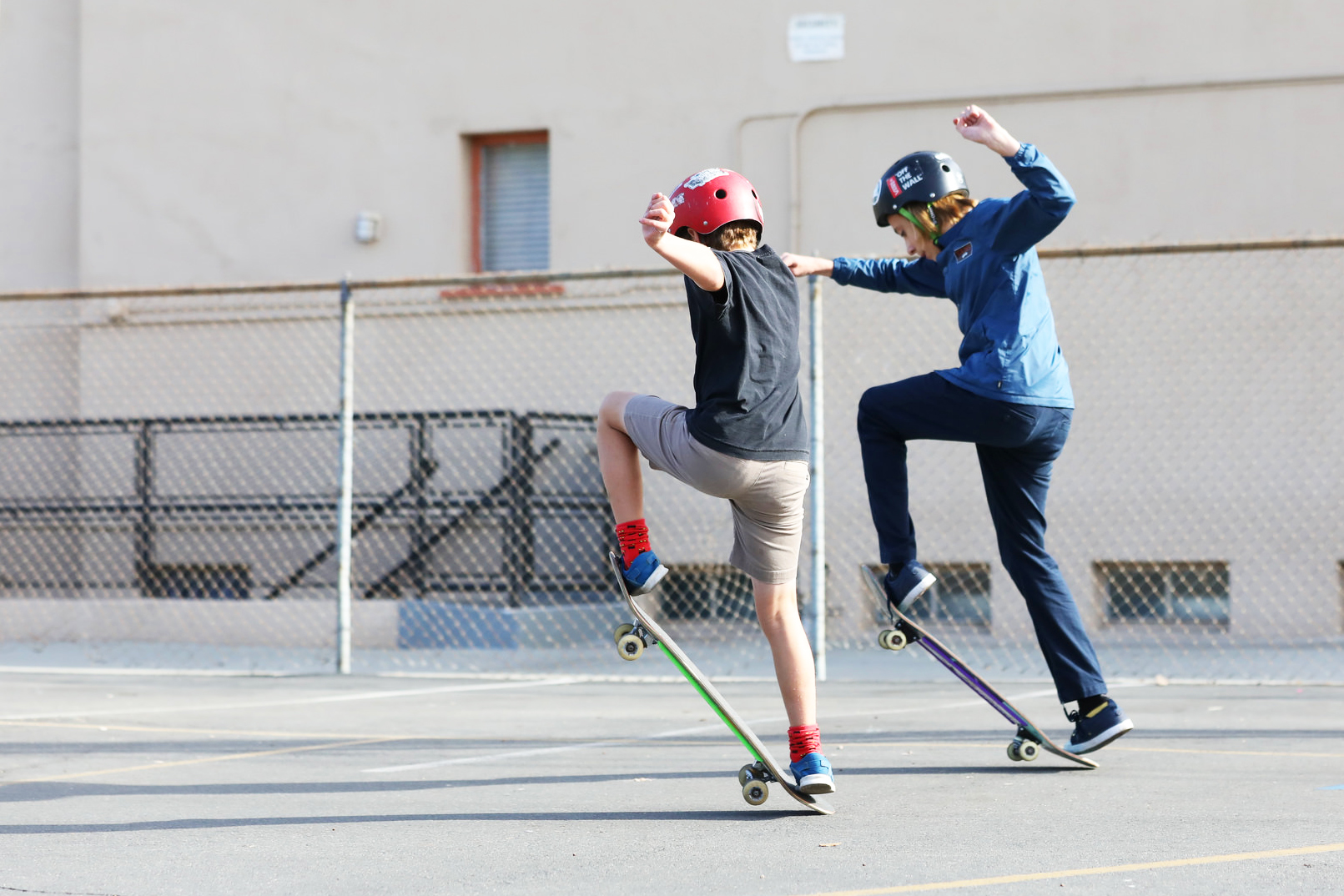 Two homeschooled boys from Compass Charter Schools on skateboards doing an ollie